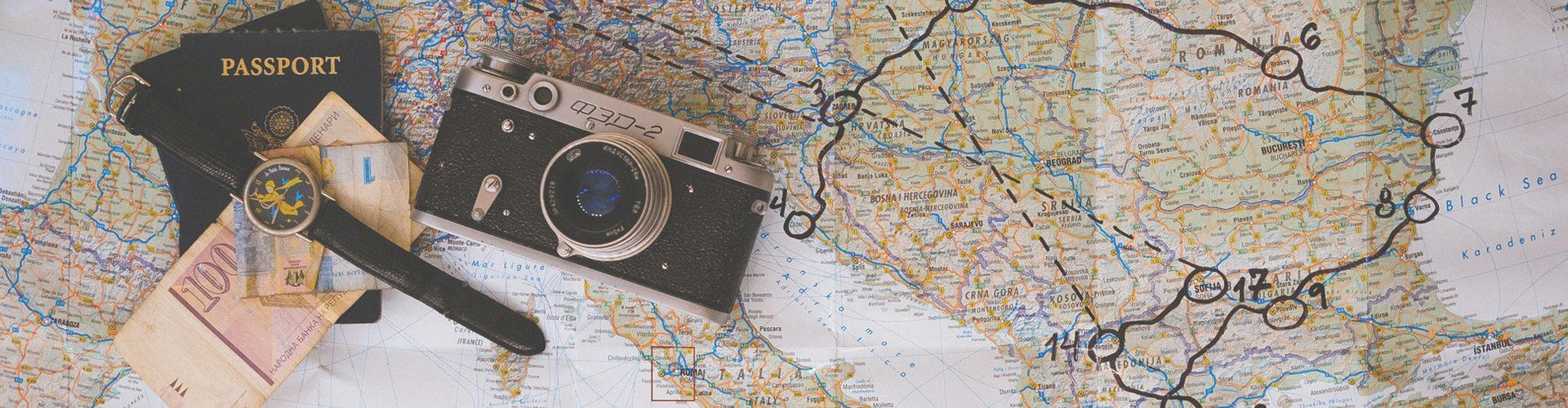 saving money - cash and passport on a map