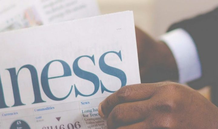 small business security - man reading business newspaper