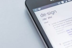 "designing a small business website - phone showing dictionary spelling of ""design"""