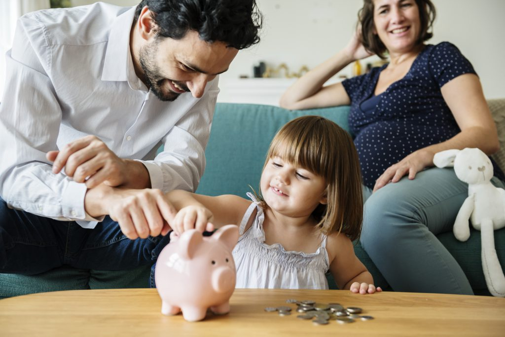 family with piggy bank Providing Financial Security For Our Children