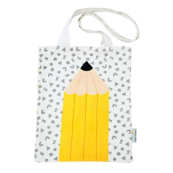 Tote bag with a large yellow pencil on the front.