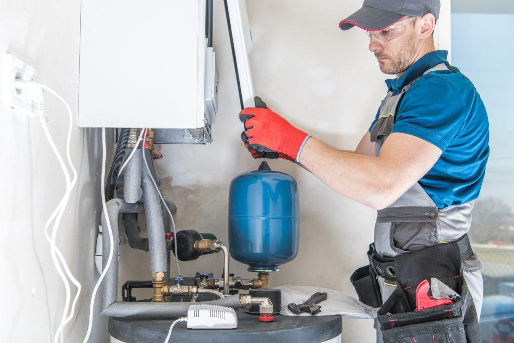 Engineer servicing boiler - ways to bring your heating bills down