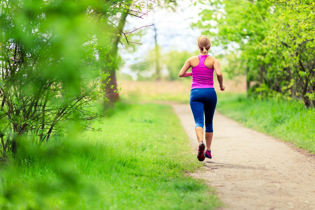 Woman jogging in park - Tips To Save Money - cancel gym membership and run outdoors.
