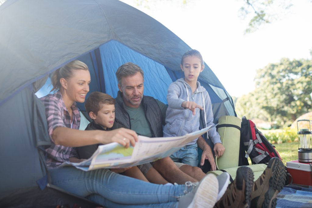 family inside a tent - dampen your camping experience