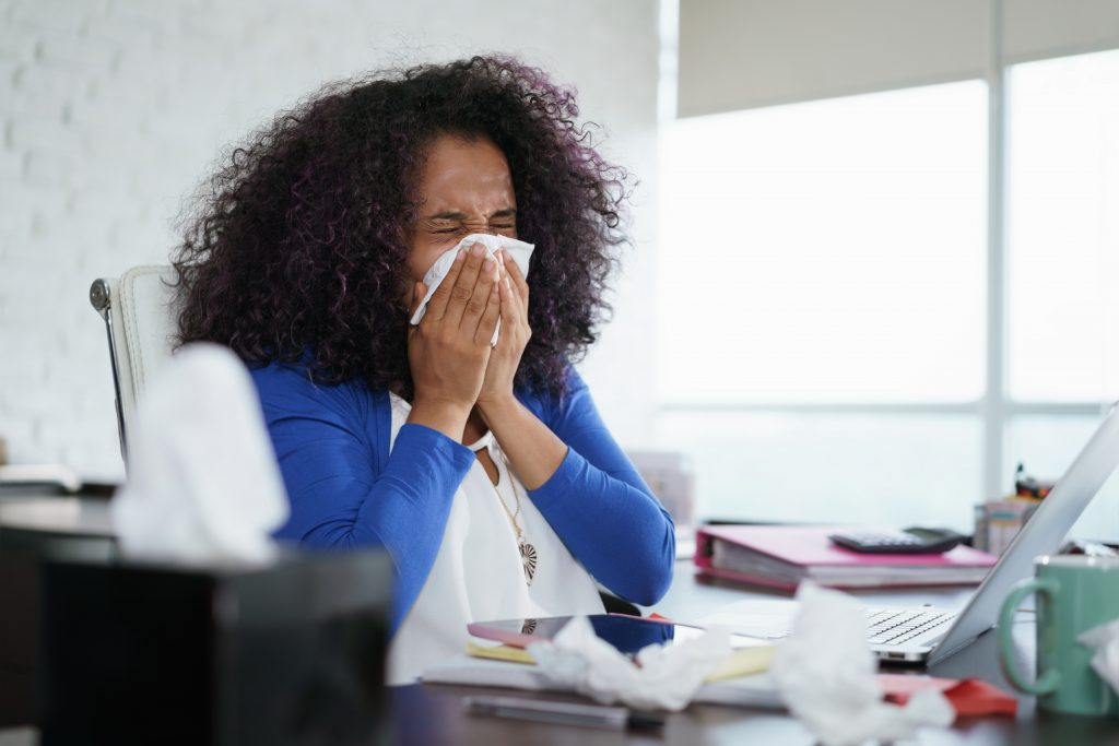 Black Woman Working from Home And Sneezing with hayfeer. don't ignore your allergy symptoms -