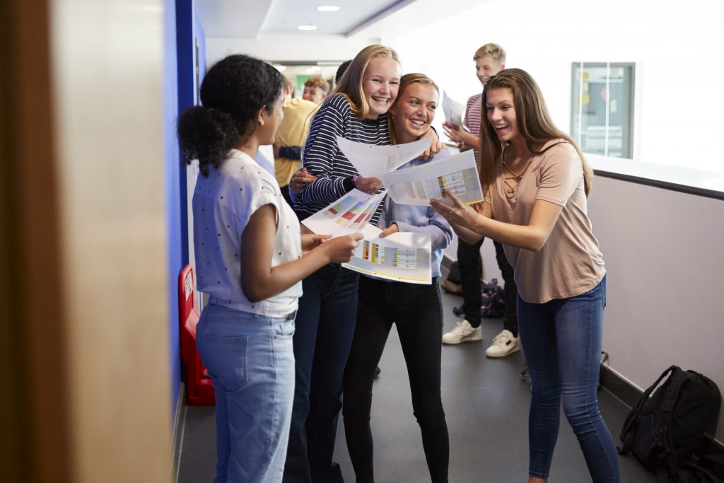 students collecting GCSE's - New GCSE Grades Explained