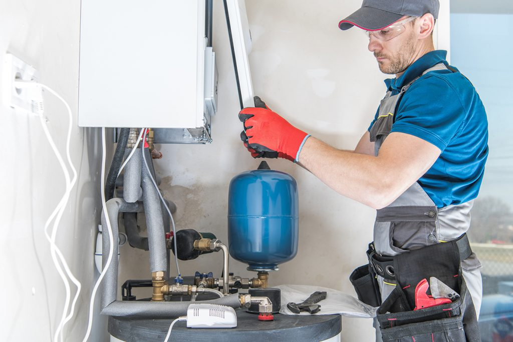 Engineer working on replacing the boiler at home