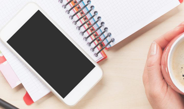 how to make your screen brighter - smartphone sat on top of a diary