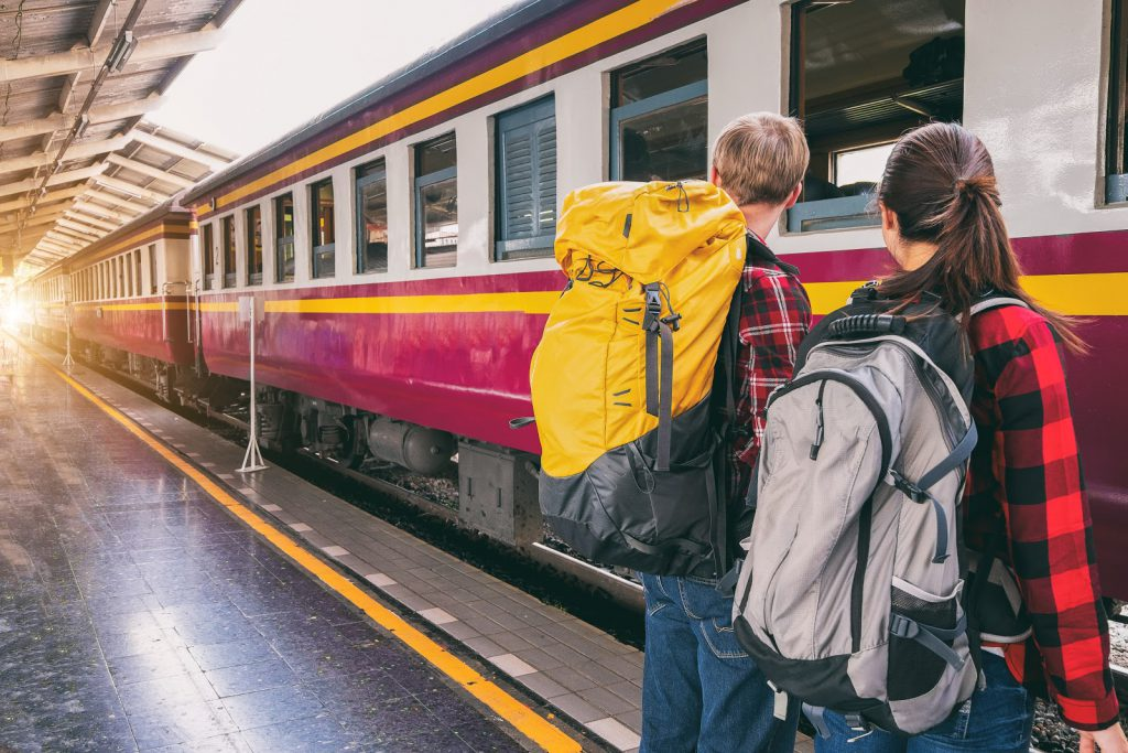Backpackers boarding a train