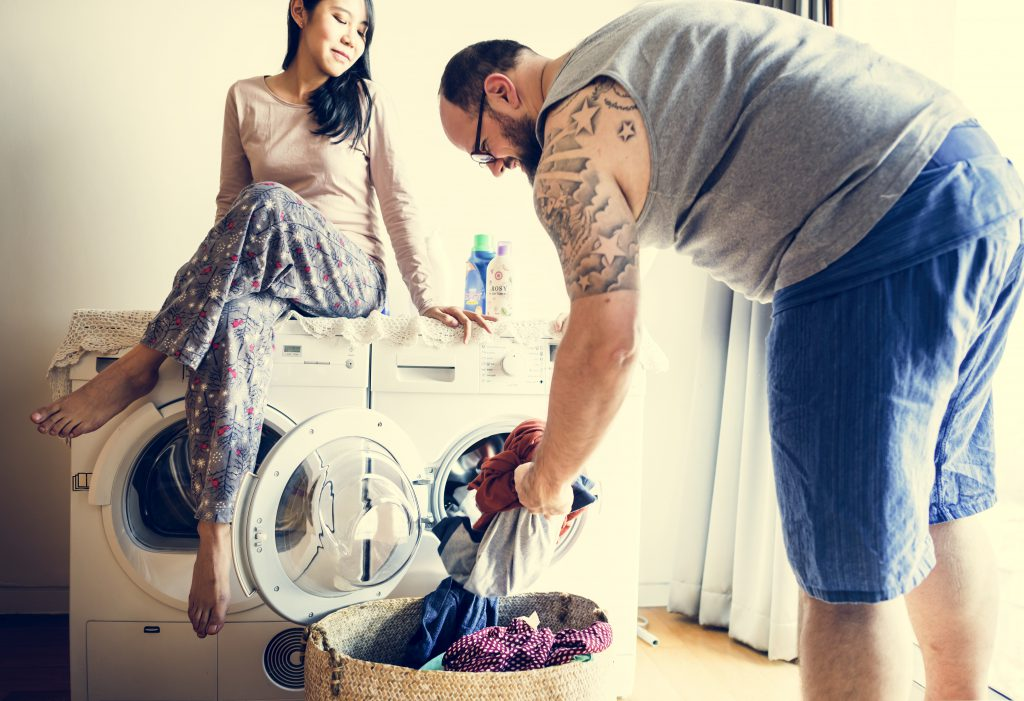 couple doing laundry - Ways Your Dirty Laundry Could Strengthen Your Relationship