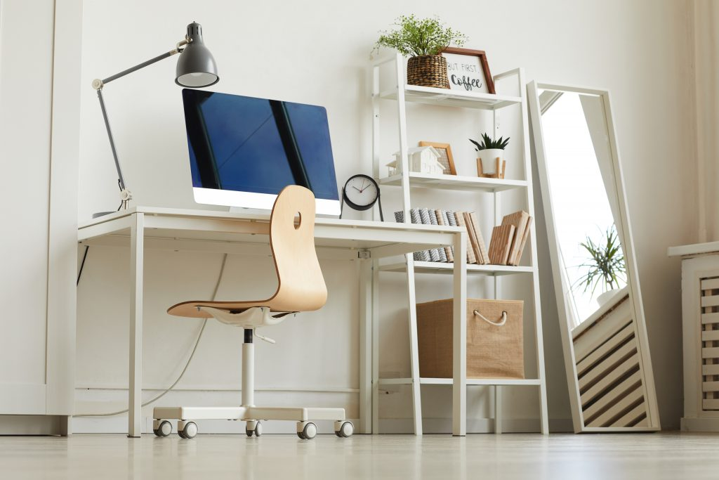 Ways to save money when working from home - low angle look up at a desk at home