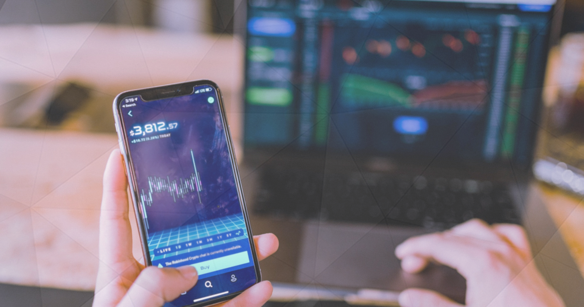 Best Forex Indicators a man checks on his phone