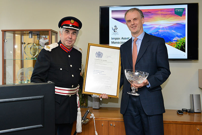 Impax CEO Ian Simm receiving the Queen's Award from Dr Knapman, Deputy Lieutenant of Greater London