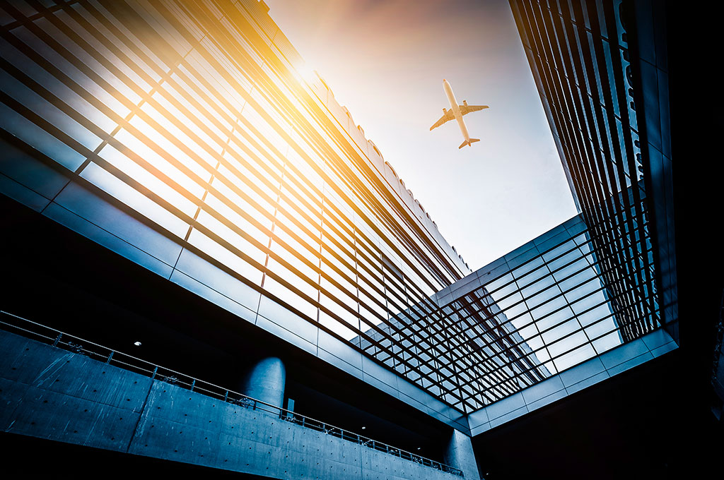 Aeroplane flying above an office building