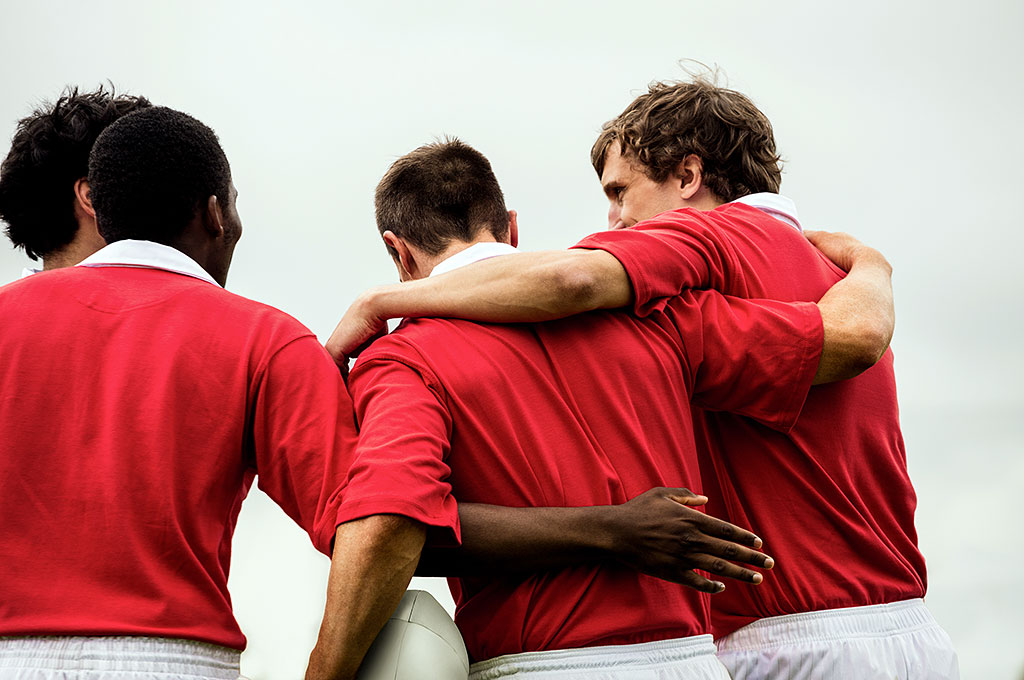 Grassroot rugby players celebrate