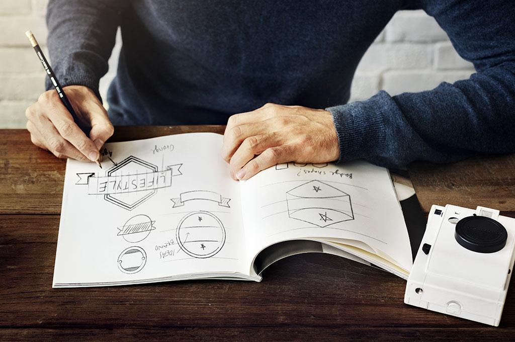 sketching design logo in pad