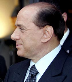 Berlusconi cuts retainers to show girls
