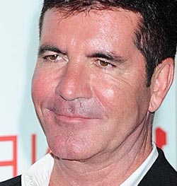 Cowell 'fighting ITV over Walsh'