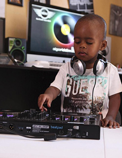 Toddler disc jockey fascinates South African fans