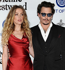Amber Heard  accuses estranged husband Johnny Depp of domestic violence
