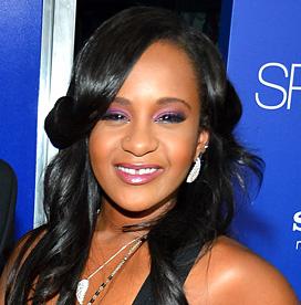 Bobbi Kristina Brown's partner loses wrongful death case  Whitney Houston, Bobby Brown, Bobbi Kristina Brown (centre)