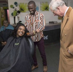 UK: Humorous Prince Charles visits Zim man's hair salon, charms owner and clients alike