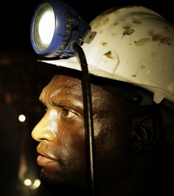 Mine  workers threaten to down tools
