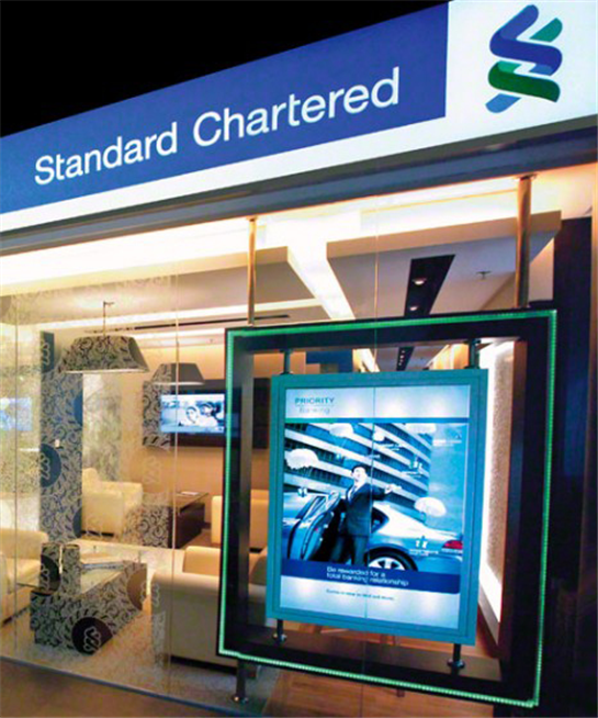 Stanchart net  profit down 30pct, to streamline operations