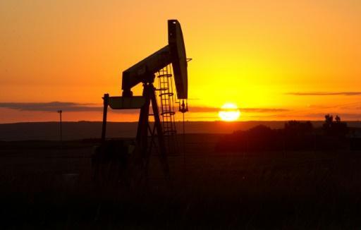 Oil prices slide after Shanghai stock market dives