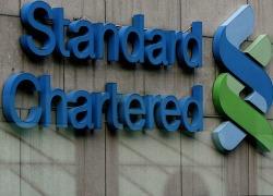 Stanchart half year profit plummets 85pct