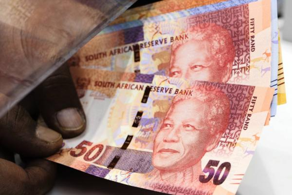 South Africa's rand consolidates gains, gold lifts stocks
