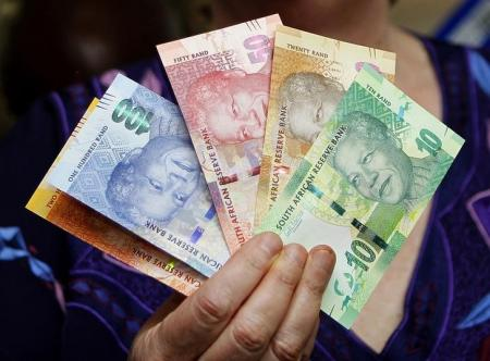 South Africa's rand slides to new low on strong U.S. data, stocks flat