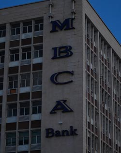 MBCA profit falls by half in dismal H1