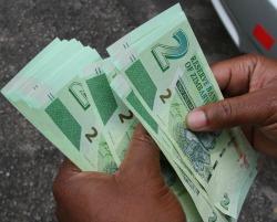 US dollar  black market thrives in broke Zim