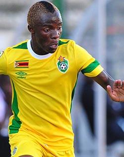 CHAN: Zim through after Burkina Faso win  Battling performance … Kudakwashe Mahachi (C) with Burkina Faso's Eric Traore and Ekise