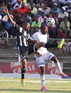 Dynamos, Highlanders held  Share of the spoils … ZPC Kariba's Ephraim Mwinga is tackled by Bosso's Ozias Zibande