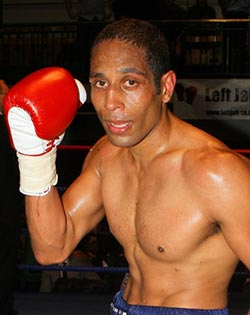 Boxer glad  he was persuaded to keep going