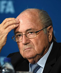 Comedian charged with trespassing after showering Blatter with fake cash