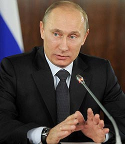 Putin says Russia Olympics ban is 'political', no boycott