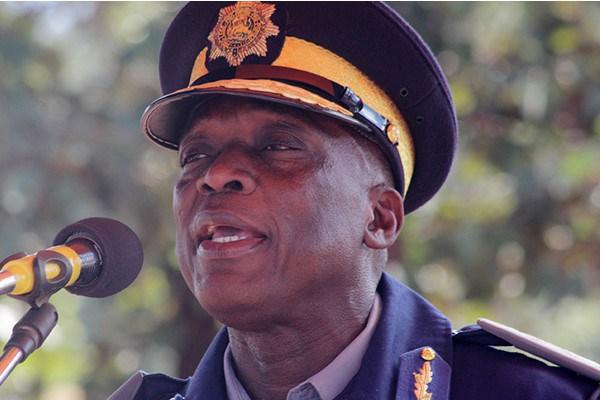 Chihuri home torching cop flees Zimbabwe