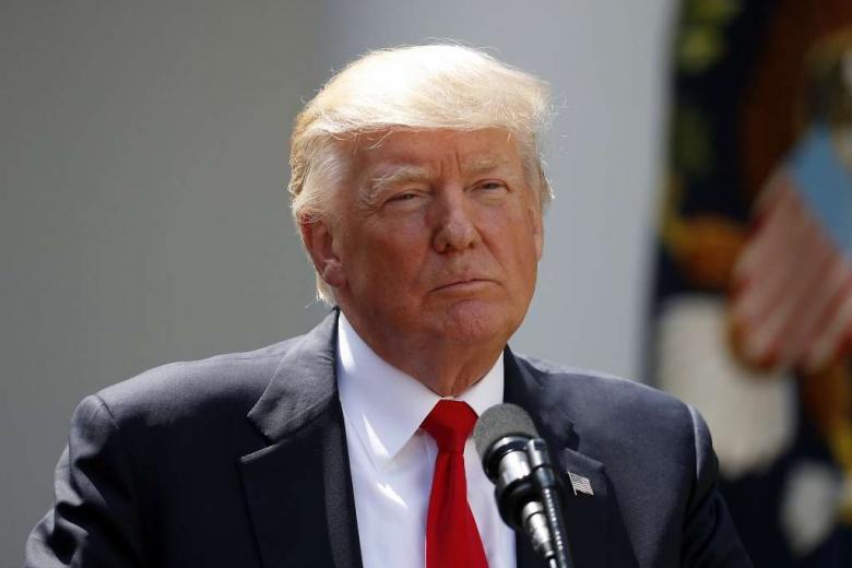 Trump fires top diplomat Tillerson, names Pompeo successor