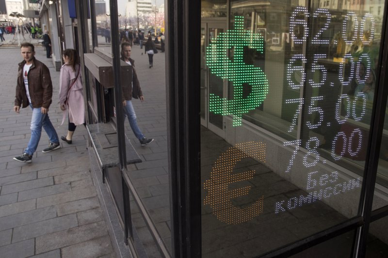 Russia currency plunges for 2nd day following US sanctions