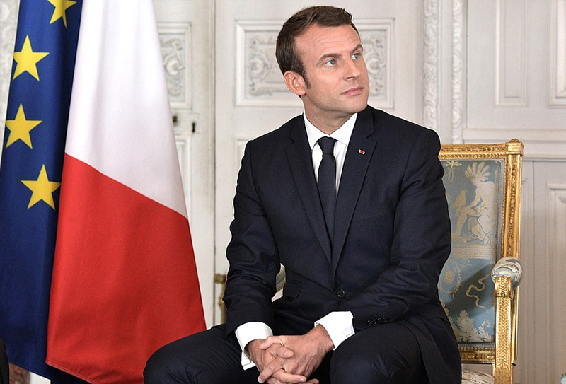 France President causes stir over 'raised middle finger' photo