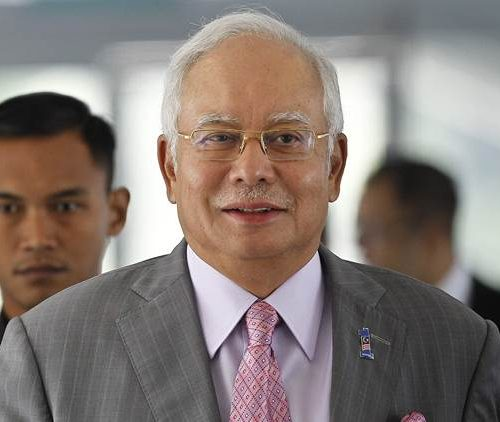 Malaysia seizes cash, jewels, designer bags in raid on ex-leader