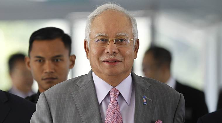 Malaysia seizes cash, jewels, designer bags in raid on ex-leader