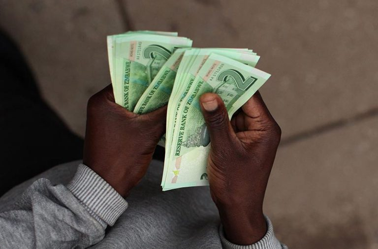 Long queues form in Harare as Zimbabwe releases new bank notes, coins