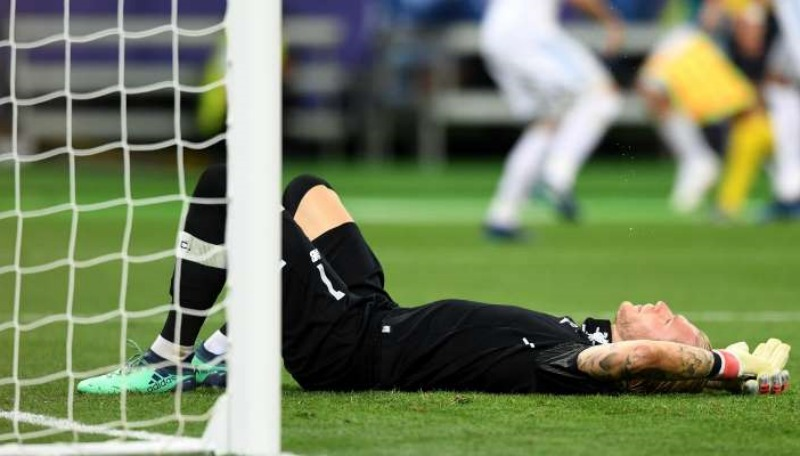 I'm sorry': Liverpool's blundering goalkeeper Loris Karius begs for forgiveness as he faces ridicule and abuse over Champions League final defeat – and shields his face as team land back home