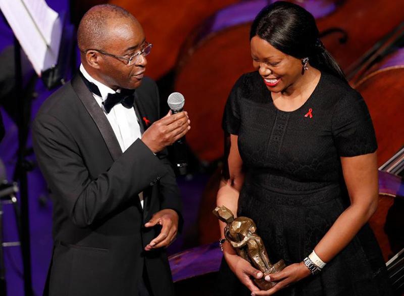 British prime minister honours Masiyiwa and wife