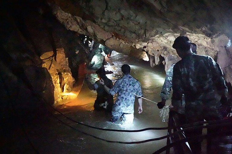 Thai boys spend eighth night in flooded cave as weather eases