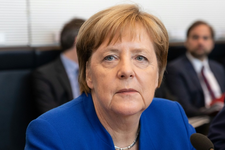 Merkel dodges political bullet with controversial migrant deal